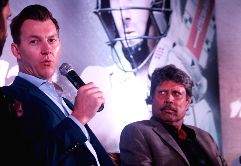 Former cricketers Kapil Dev and Brett Lee during a panel discussion regarding upcoming India vs New Zealand Test Series in New Delhi, on Sept 19, 2016. - Kapil Dev