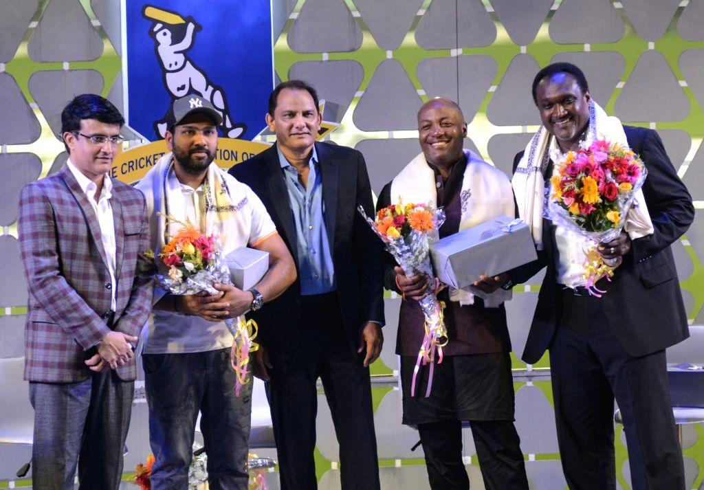 Former cricketers Sourav Ganguly, Mohammad Azharuddin, Brian Lara, and Carl Hooper with Indian cricketer Rohit Sharma during Jagmohan Dalmiya Annual Conclave in Kolkata on Nov 2, 2018. - Sourav Ganguly, Azharuddin and Rohit Sharma
