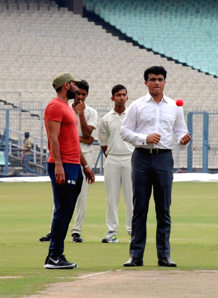 Former cricketers Sourav Ganguly tries his hands at bowling during a panel discussion in Kolkata, on June 16, 2016. - Sourav Ganguly