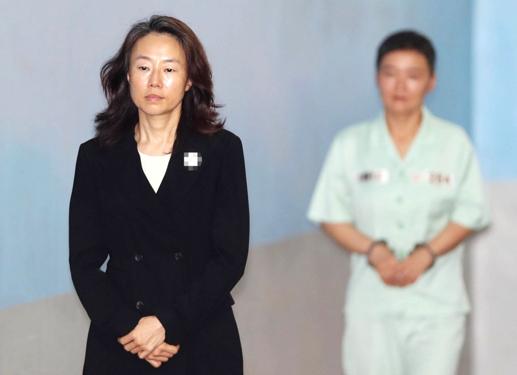 Former Culture Minister Cho Yoon-sun enters a court in Seoul on June 11, 2018, to stand trial on charges that she kept a list of media figures critical of the Park Geun-hye government to bar ... - Cho Yoon