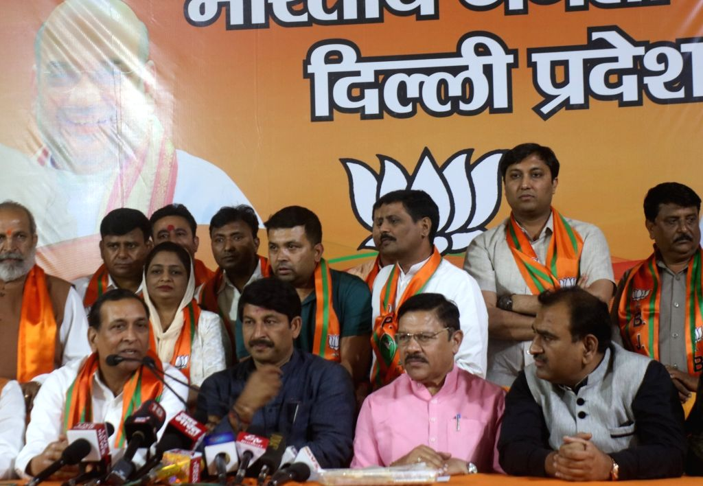 Former Delhi Minister and Congress MLA Raj Kumar Chauhan who joined the BJP today, talks to media persons in the presence of the party's Delhi chief Manoj Tiwari, at BJP headquarter in New ... - Kumar Chauhan