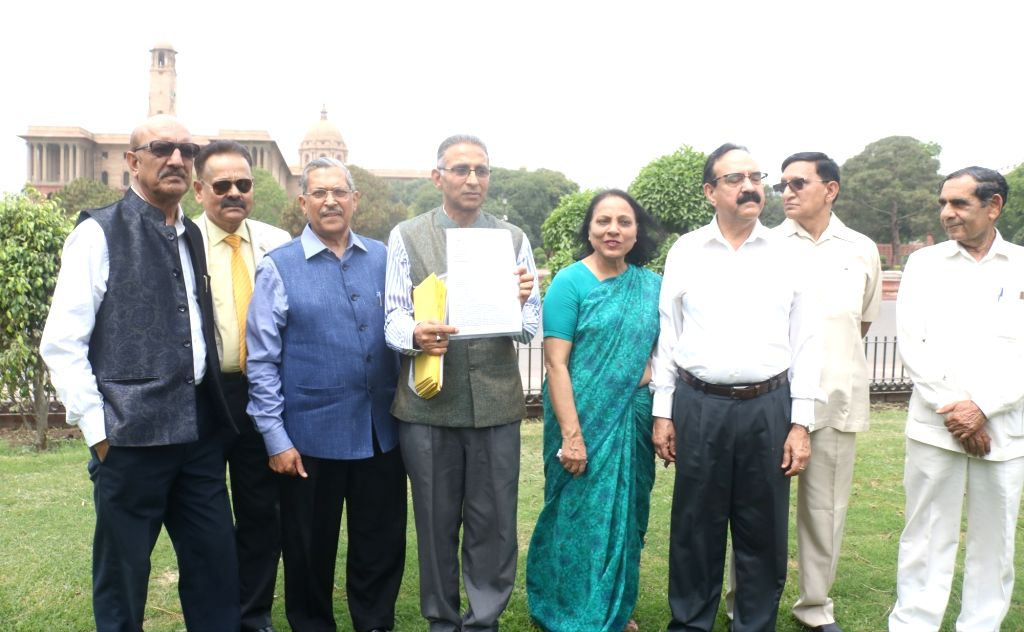 Former Delhi Police Commissioner R.S. Gupta and other bureaucrats, after submitting a memorandum to President Ram Nath Kovind regarding the Election Commission of India's Model Code of ... - Code, S. Gupta and Nath Kovind
