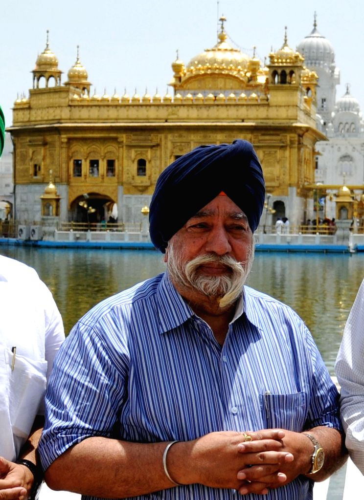 Former Delhi Sikh Gurdwara Management Committee chief Paramjit Singh Sarna paying obeisance at Golden Temple in Amritsar on June 17, 2014.