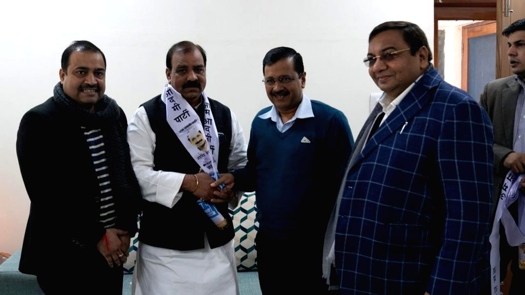Former Delhi Youth Congress President Jagdish Yadav joins AAP in the presence of party president and Chief Minister Arvind Kejriwal and MP Sushil Gupta, in New Delhi on Jan 11, 2020. - Arvind Kejriwal, Jagdish Yadav and Sushil Gupta