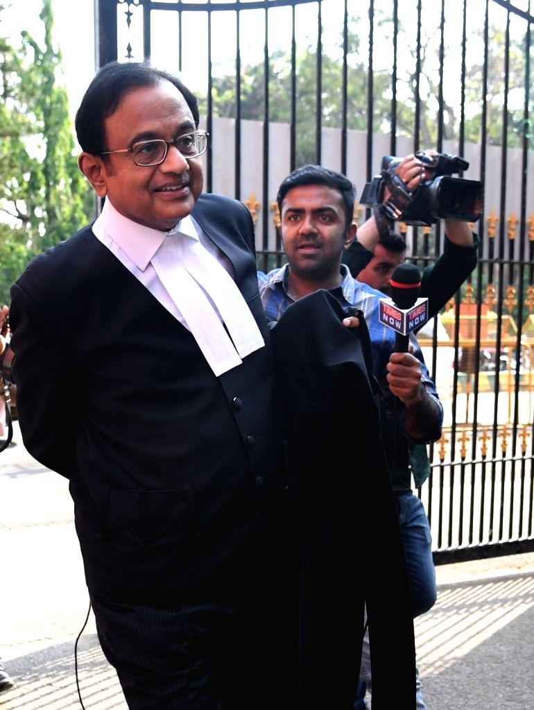 Former Finance Minister P. Chidambaram outside Karnataka High Court in Bangalore. The CBI on Tuesday raided the residences of Chidambaram and his son Karti in Chennai, Delhi and various ... - P. Chidambaram