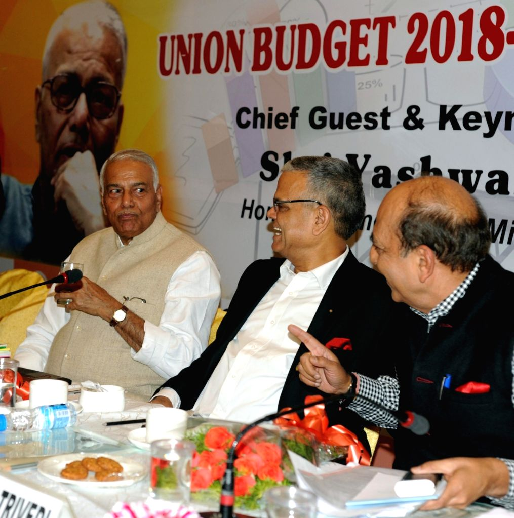 "Former Finance Minister Yashwant Sinha, TMC MP Dinesh Trivedi and other dignitaries during a Panel Discussion and Interactive Session on ""Union Budget 2018-19"" in Kolkata on Feb 6, ... - Yashwant Sinha"