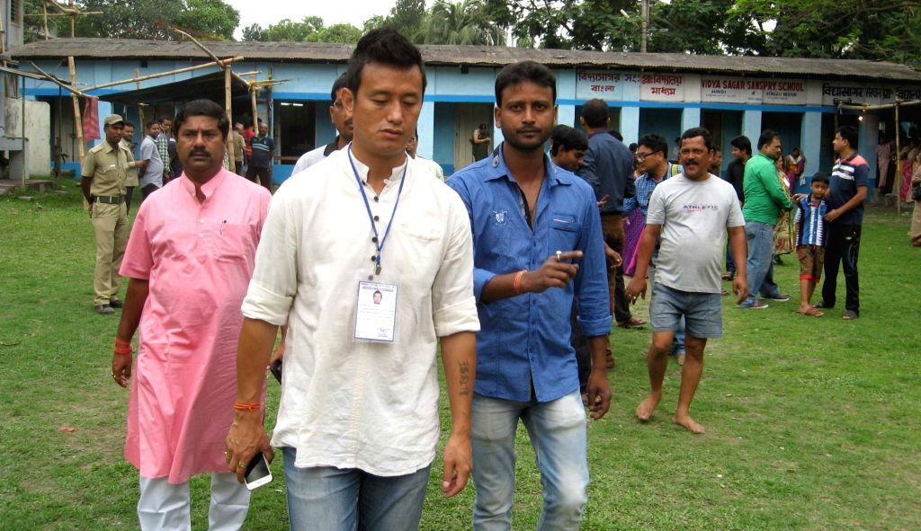 Former footballer and Trinamool Congress candidate Baichung Bhutia at a polling booth during the third phase of state assembly election in Siliguri on April 17, 2016.