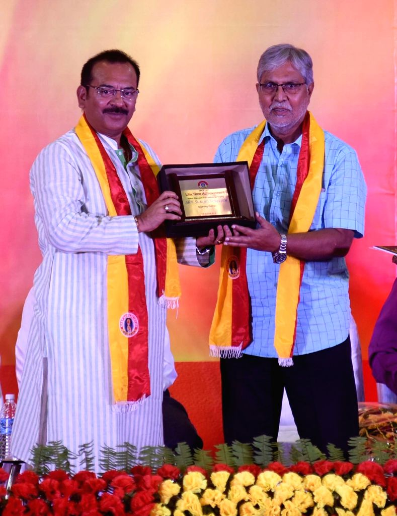 Former footballer Surajit Sengupta being felicitated by West Bengal Minister Aroop Biswas during 99th Foundation Day celebrations of East Bengal Football Club in Kolkata, on Aug 1, 2018. - Aroop Biswas