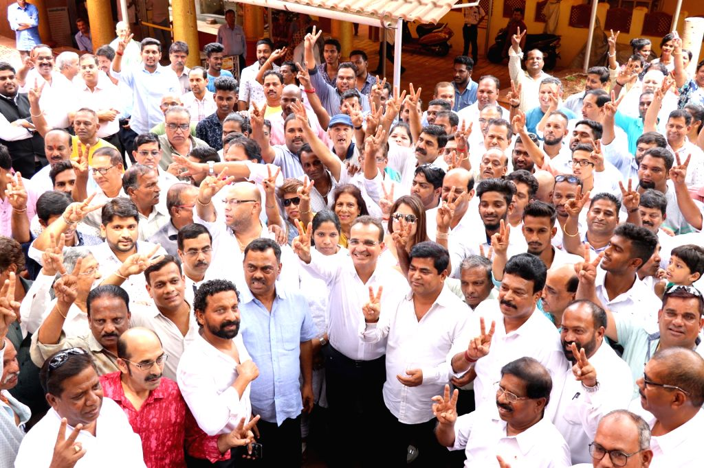 Former Goa Minister and Congress candidate for the Panaji bypolls, Atanasio 'Babush' Monserrate shows victory sign after filing his nomination, in Panaji on April 26, 2019.