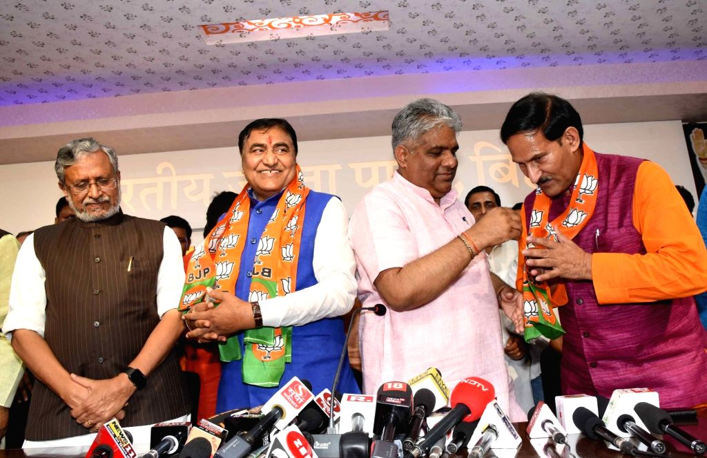 Former HAM-S National Vice-President Mahachandra Prasad Singh and former Congress leader Binod Sharma join BJP in the presence of Bihar Deputy Chief Minister Sushil Kumar Modi and BJP leader ... - Sushil Kumar Modi, Mahachandra Prasad Singh, Binod Sharma and Bhupender Yadav