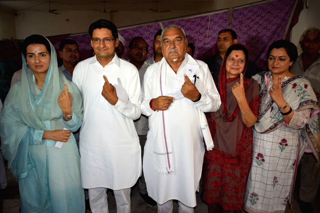 Former Haryana Chief Minister Bhupinder Singh Hooda shows his forefinger marked with indelible ink after casting vote during the sixth phase of 2019 Lok Sabha elections at Sanghi village of ... - Bhupinder Singh Hooda