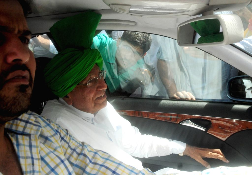 Former Haryana Chief Minister Om Prakash Chautala discharged from hospital in New Delhi on May 23, 2013. (Photo: IANS) - O