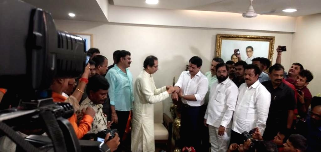 Former high-profile encounter specialist Pradeep Sharma joins Shiv Sena in the presence of party chief Uddhav Thackeray in Mumbai on Sep 13, 2019. - Pradeep Sharma