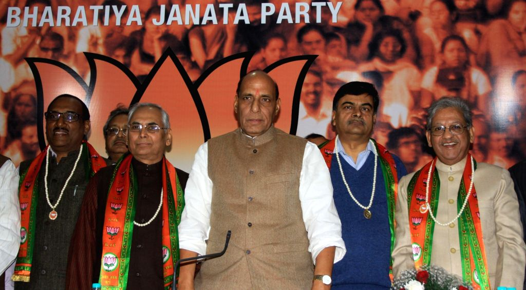 Former Home Secretary R.K. Singh (C) with Former Congress Leader, Sunil Shastri (R) and BJP president, Rajnath Singh after joining BJP in New Delhi on Dec.13, 2013. - K. Singh