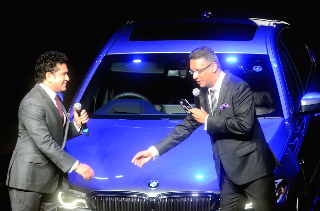 Former India cricketer Sachin Tendulkar and BMW India President Vikram Pawah during the launch of BMW 5 Series 2017 model in Mumbai on June 29, 2017. - Sachin Tendulkar