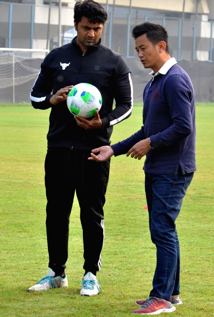 Former India football captain Bhaichung Bhutia along with actor turned TMC MP Dev alias Deepak Adhikari during a practice session for a upcoming Bengali film shooting in Kolkata on Dec 8, ... - Bhaichung Bhutia