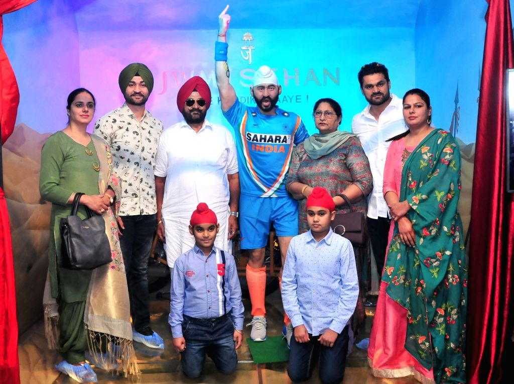 Former India hockey captain Sandeep Singh along with his family members unveils his wax statue at Wax Museum in Jaipur's Nahargarh Fort on Nov. 1, 2018. - Sandeep Singh
