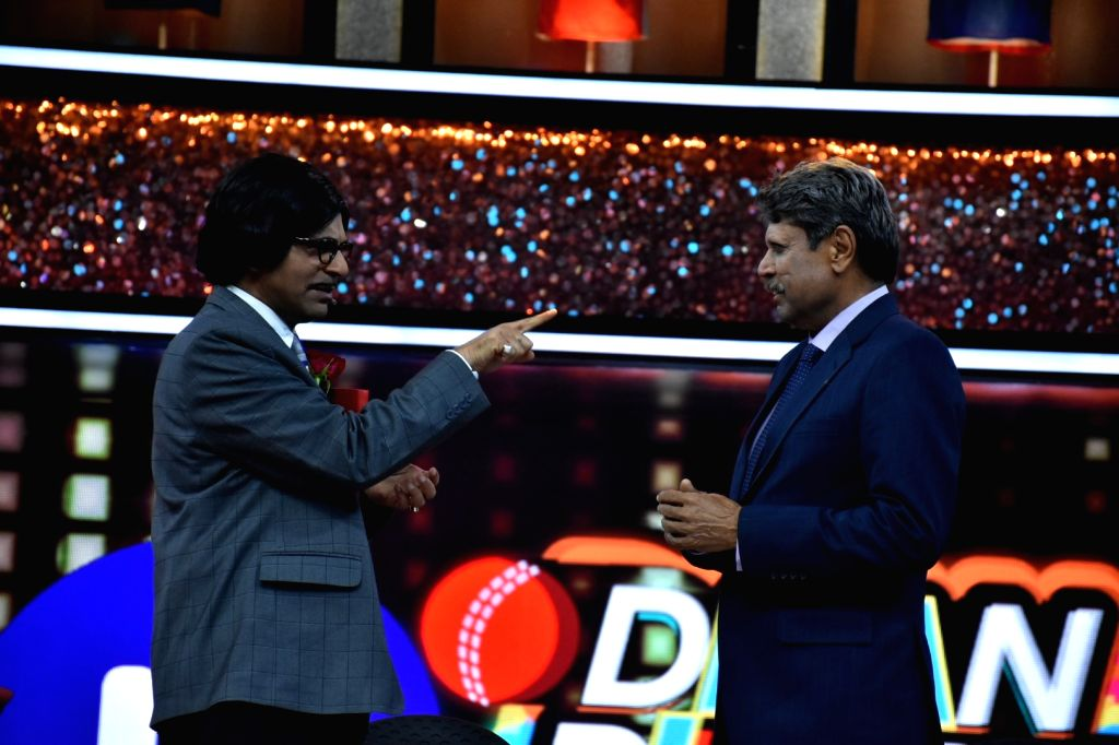 "Former India skipper Kapil Dev and actor Sunil Grover at the launch of cricket and comedy show ""Dhan Dhana Dhan"" in Mumbai on April 4, 2018. - Sunil Grover and Kapil Dev"