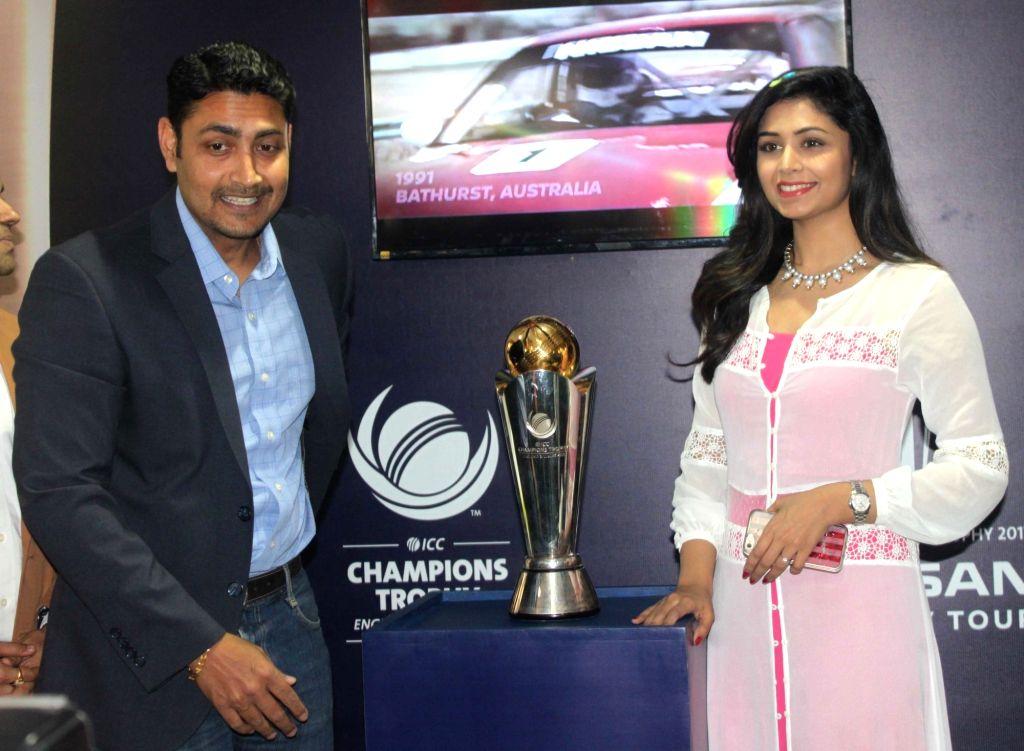 Former India wicketkeeeper Deep Dasgupta and actress Ritabari dasgupta unveils The ICC Champions Trophy 2017, in Kolkata on March 2, 2017. - Ritabari