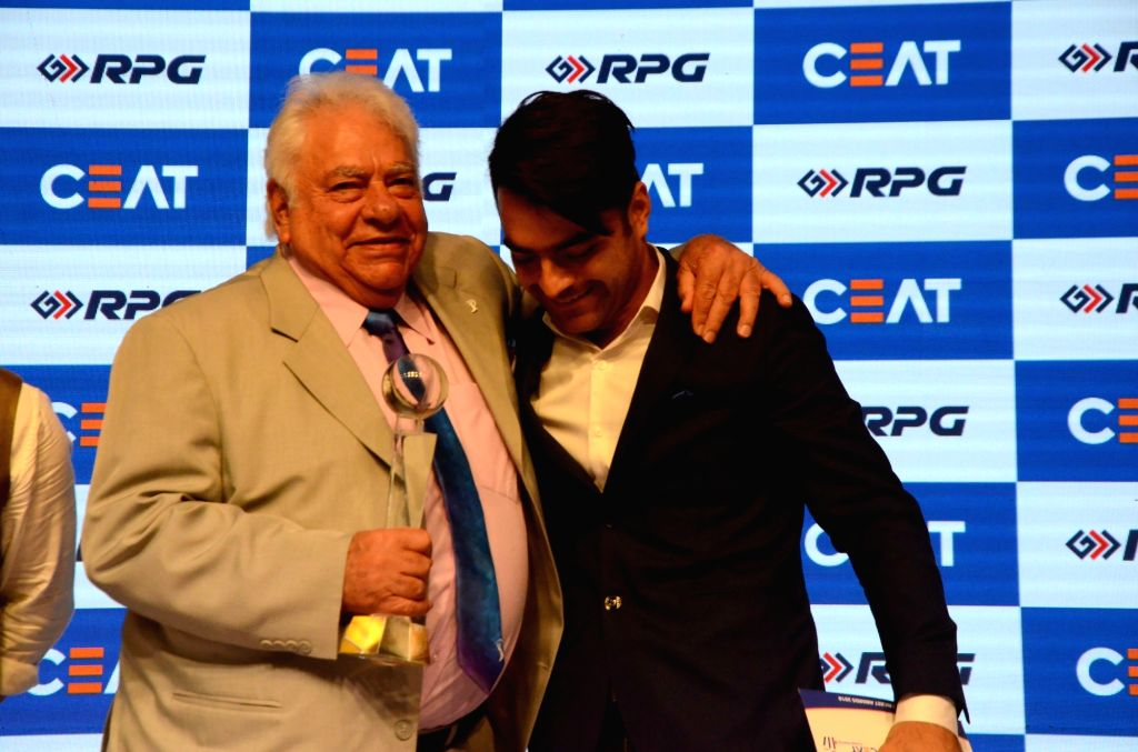 Former Indian cricketer Farokh Engineer with cricketer Rashid Khan during Ceat cricket rating award 2017-18, in Mumbai on May 28, 2018. - Rashid Khan
