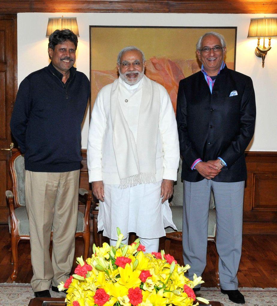 Former Indian cricketer Kapil Dev calls on the PM Modi, Vivek Khushalani, President of `KHUSHII` an NGO is also seen, in New Delhi on Dec 13, 2014.