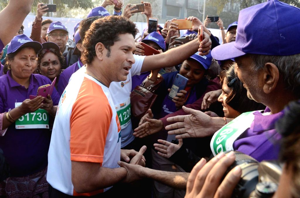 Former Indian cricketer Sachin Tendulkar interacts with the participants during the flagging off ceremony of IDBI Federal Life Insurance Kolkata Full Marathon, on Feb 3, 2019. - Sachin Tendulkar
