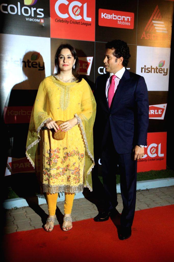 Former Indian cricketer Sachin Tendulkar along with his wife Anjali Tendulkar during the media interaction for the upcoming Celebrity Cricket League 4 in Mumbai on December 20, 2013. - Sachin Tendulkar