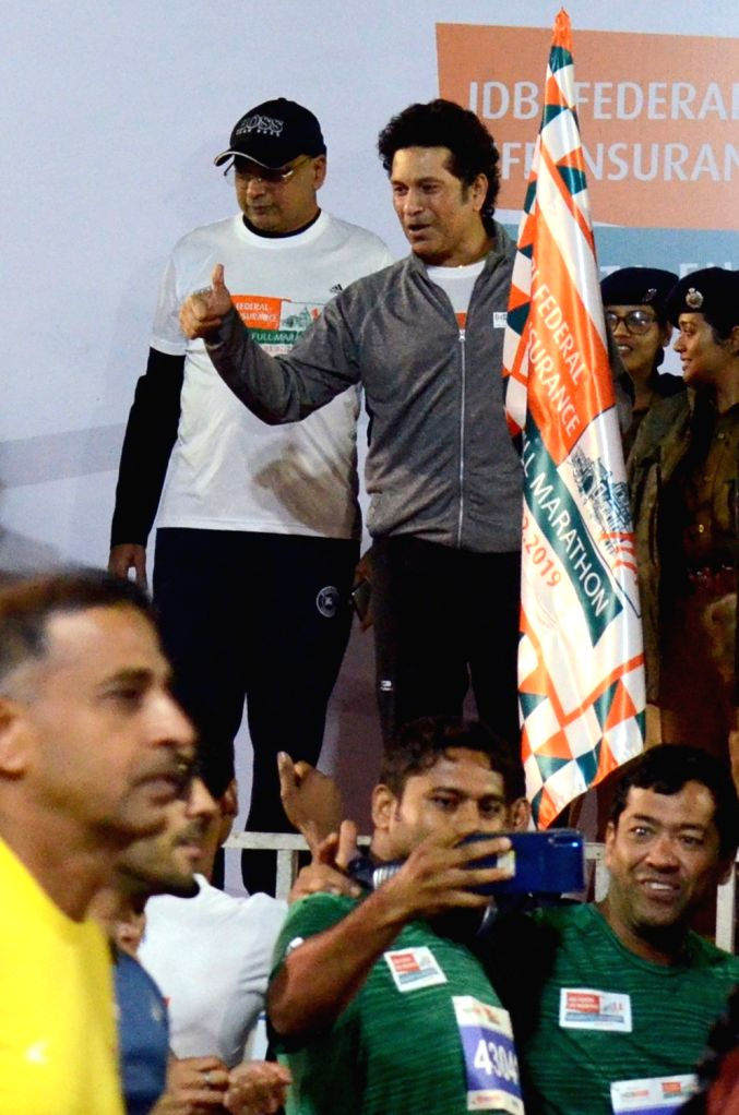 Former Indian cricketer Sachin Tendulkar flags off the IDBI Federal Life Insurance Kolkata Full Marathon, on Feb 3, 2019. - Sachin Tendulkar