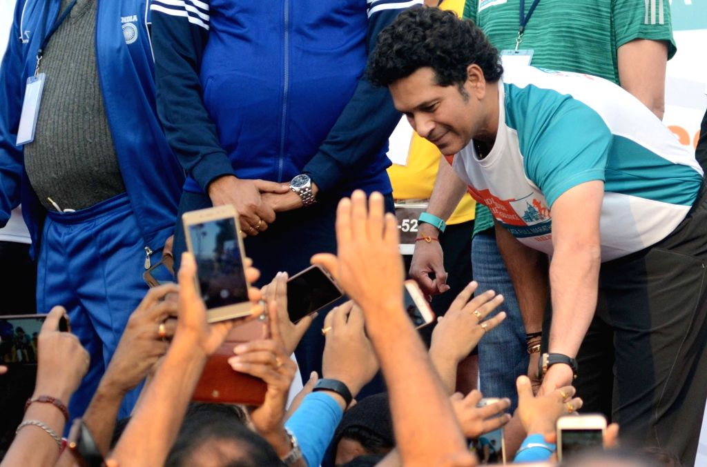 Former Indian cricketer Sachin Tendulkar greets the participants during the flagging off ceremony of IDBI Federal Life Insurance Kolkata Full Marathon, on Feb 3, 2019. - Sachin Tendulkar