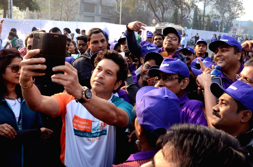 Former Indian cricketer Sachin Tendulkar poses for selfies with participants during the flagging off ceremony of IDBI Federal Life Insurance Kolkata Full Marathon, on Feb 3, 2019. - Sachin Tendulkar
