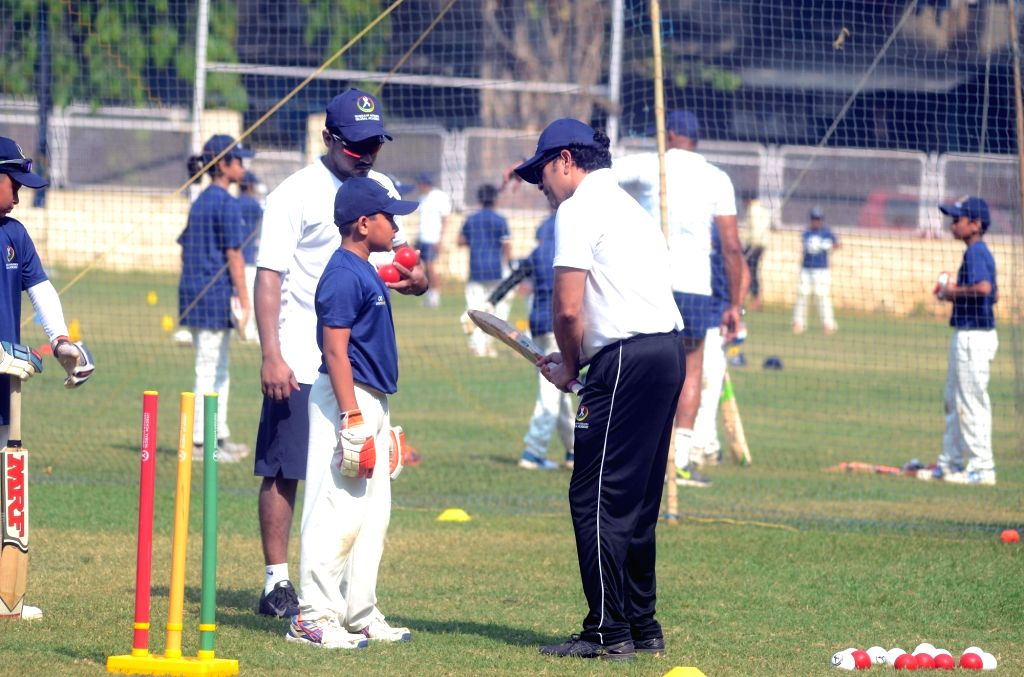 Former Indian cricketer Sachin Tendulkar trains young players at the Tendulkar Middlesex Global Academy in Mumbai on Nov 6, 2018. - Sachin Tendulkar