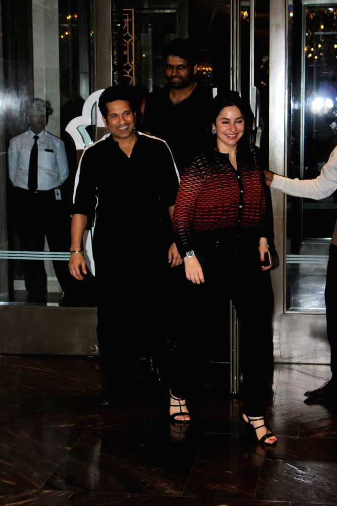 Former Indian cricketer Sachin Tendulkar with his wife Dr Anjali during the engagement ceremony of Zaheer Khan and Sagarika Ghatge, in Mumbai, on May 23, 2017. - Sachin Tendulkar and Zaheer Khan