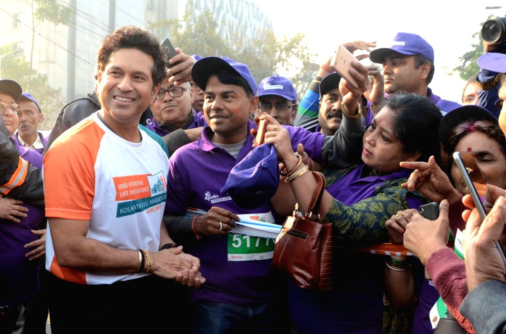Former Indian cricketer Sachin Tendulkar with the participants during the flagging off ceremony of IDBI Federal Life Insurance Kolkata Full Marathon, on Feb 3, 2019. - Sachin Tendulkar