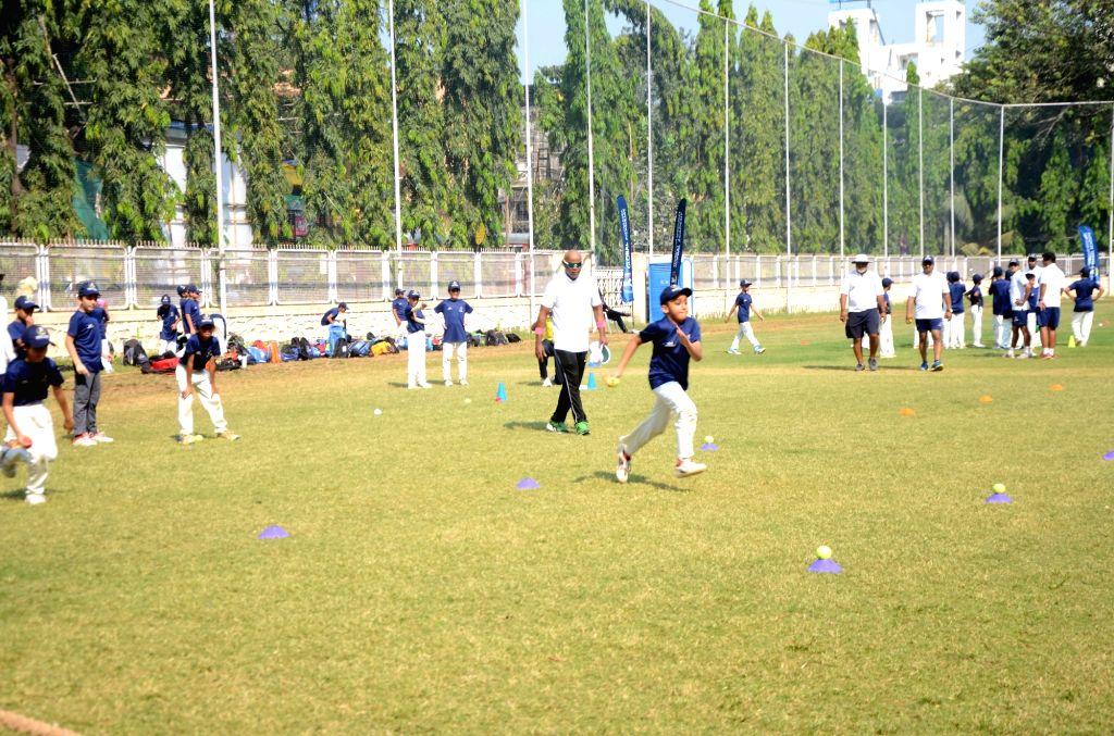 Former Indian cricketer Vinod Kambli trains young players at the Tendulkar Middlesex Global Academy in Mumbai on Nov 6, 2018.