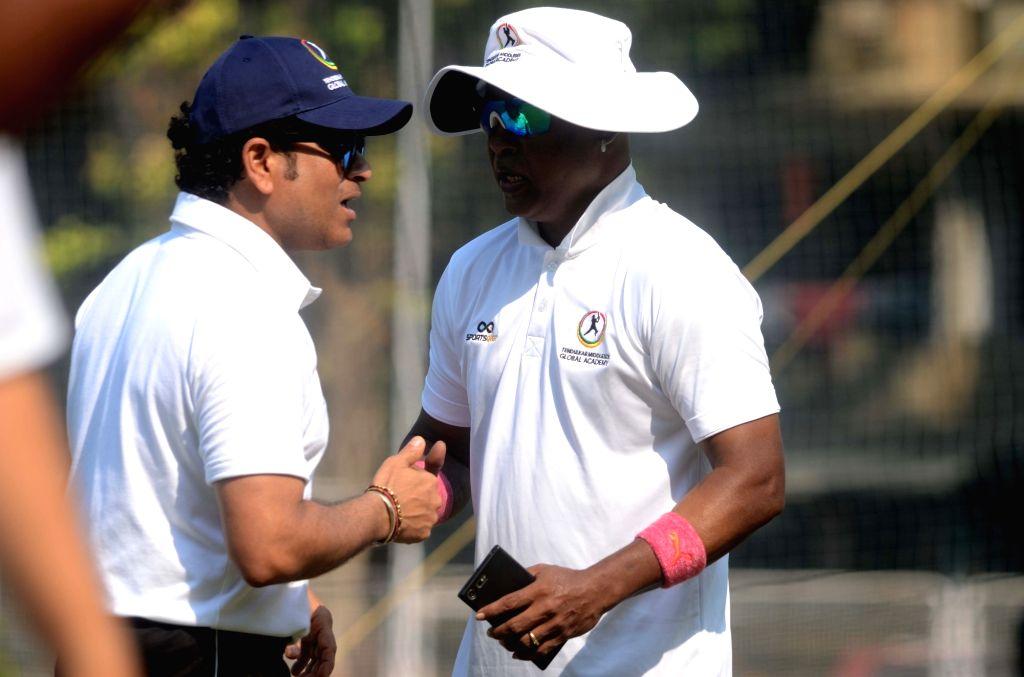 Former Indian cricketers Vinod Kambli and Sachin Tendulkar during a training session with young players at the Tendulkar Middlesex Global Academy in Mumbai on Nov 6, 2018. - Sachin Tendulkar