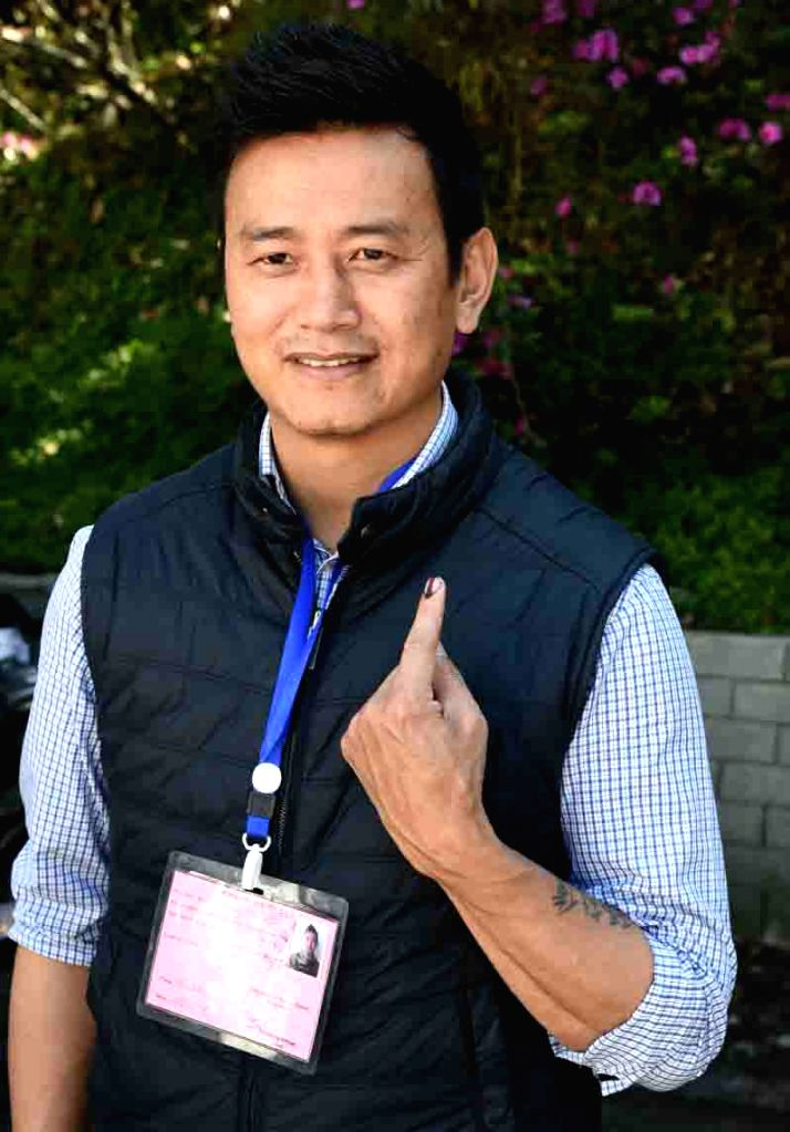 Former Indian footballer Baichung Bhutia shows his inked finger after casting vote for Lok Sabha election, in Gangtok, Sikkim, on April 11, 2019.