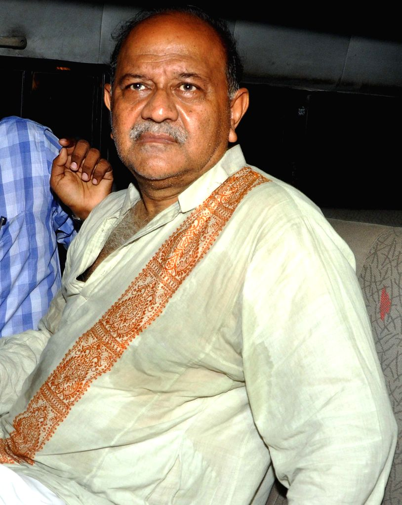 Former IPS officer and ex-Director General of Police, Rajat Majumdar arrives to appear before CBI in Kolkata on Sept 11, 2014.