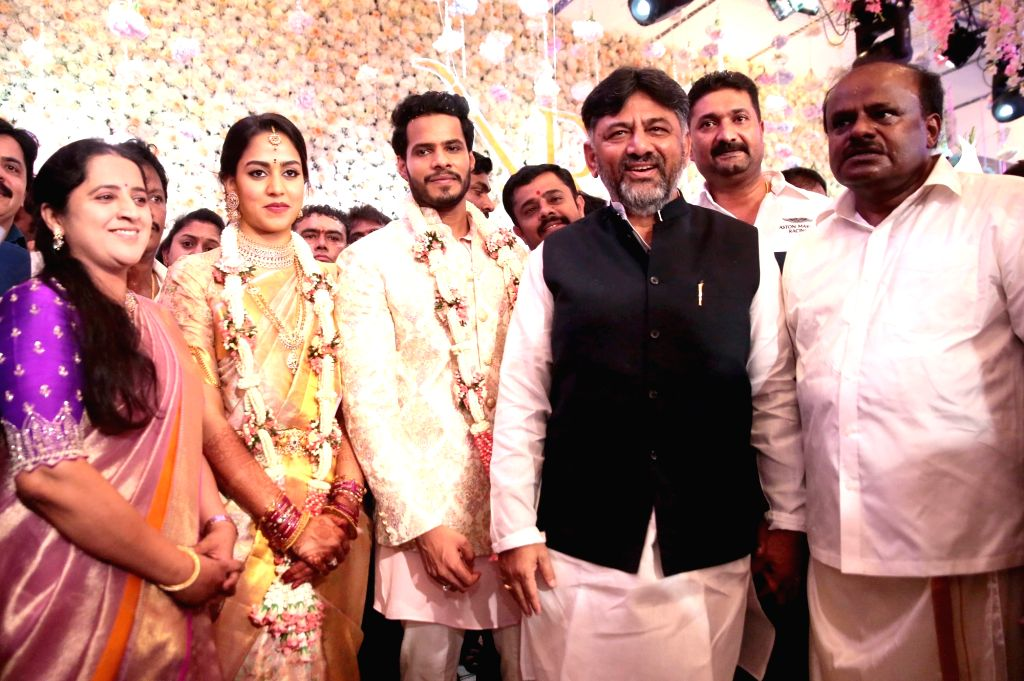 Former Karnataka Chief Minister H. D. Kumaraswamy with his son Nikhil and daughter-in-law Revathi during their engagement ceremony at the Taj West End in Bengaluru on Feb 10, 2020. Also ... - H. D. Kumaraswamy