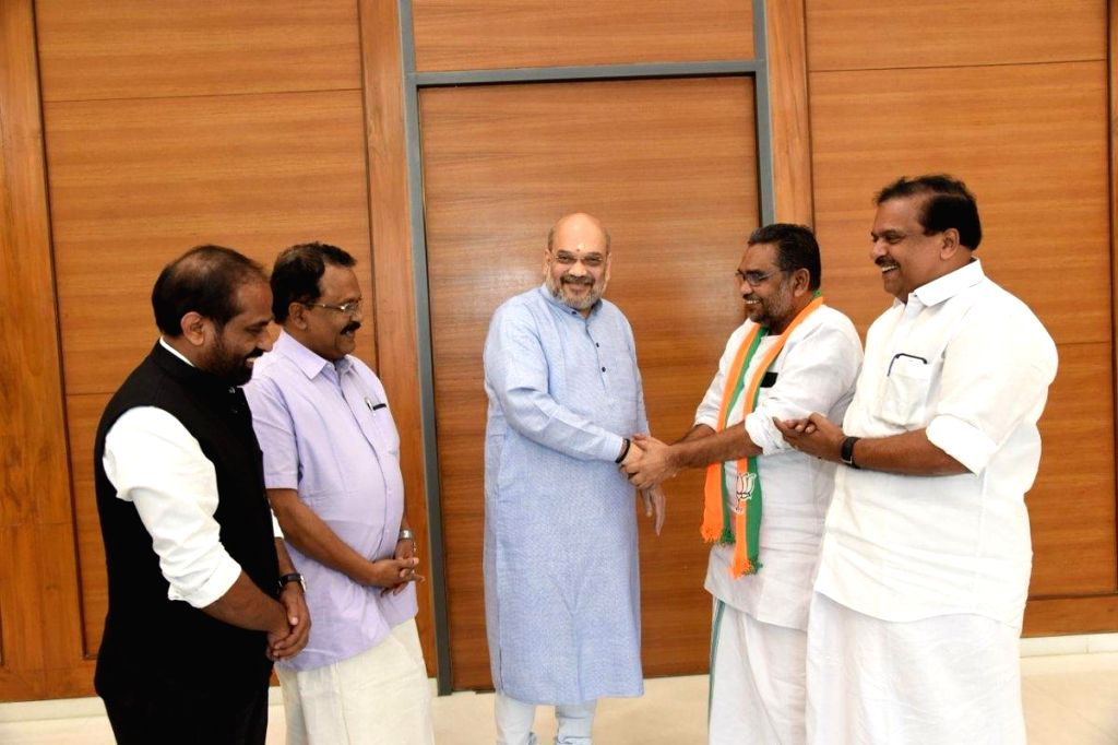 Former Kerala Public Service Commission (PSC) Chairman K. S. Radhakrishnan joins BJP in the presence of party chief Amit Shah at the party's headquarter in New Delhi, on March 17, 2019. - Amit Shah