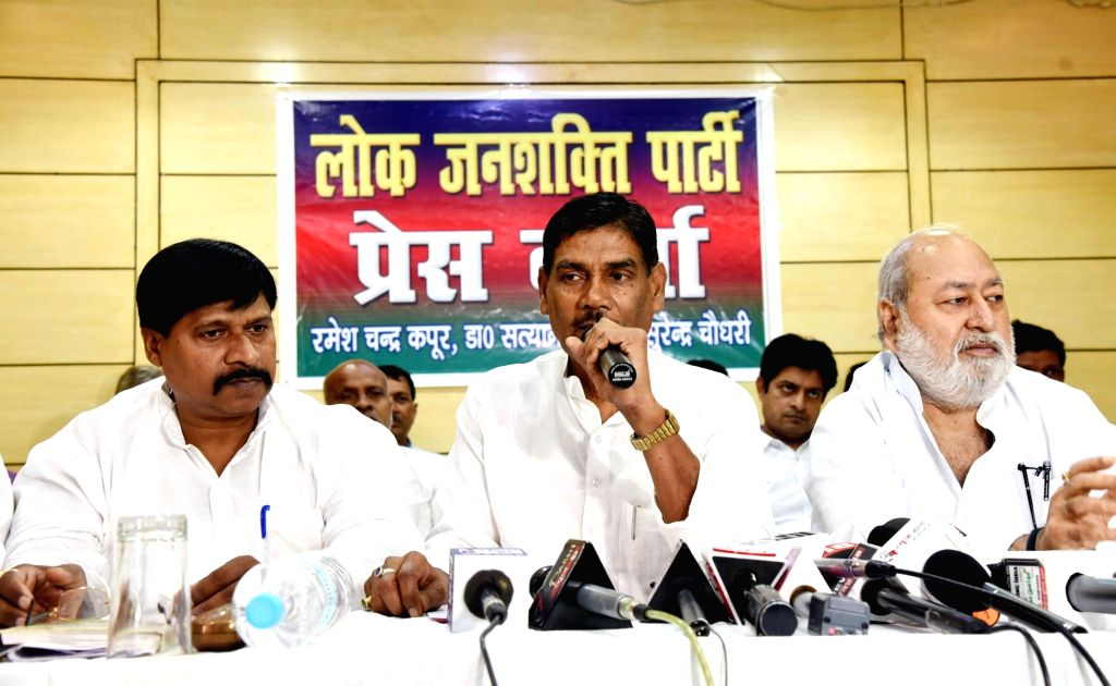 Former Lok Janshakti Party (LJP) leader Satyanand Sharma addresses a press conference to announce his new party LJP (Secular) after resigning from LJP, in Patna on June 13, 2019. BJP ally and ... - Ram Vilas Paswan and Satyanand Sharma