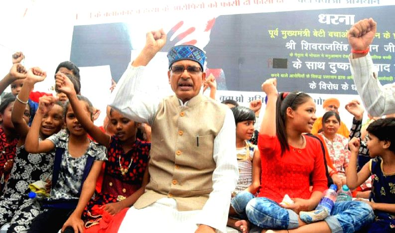 Former Madhya Pradesh Chief Minister Shivraj Singh Chouhan stages a sit-in demonstration against the rape of a minor, in Bhopal on July 17, 2019. - Shivraj Singh Chouhan