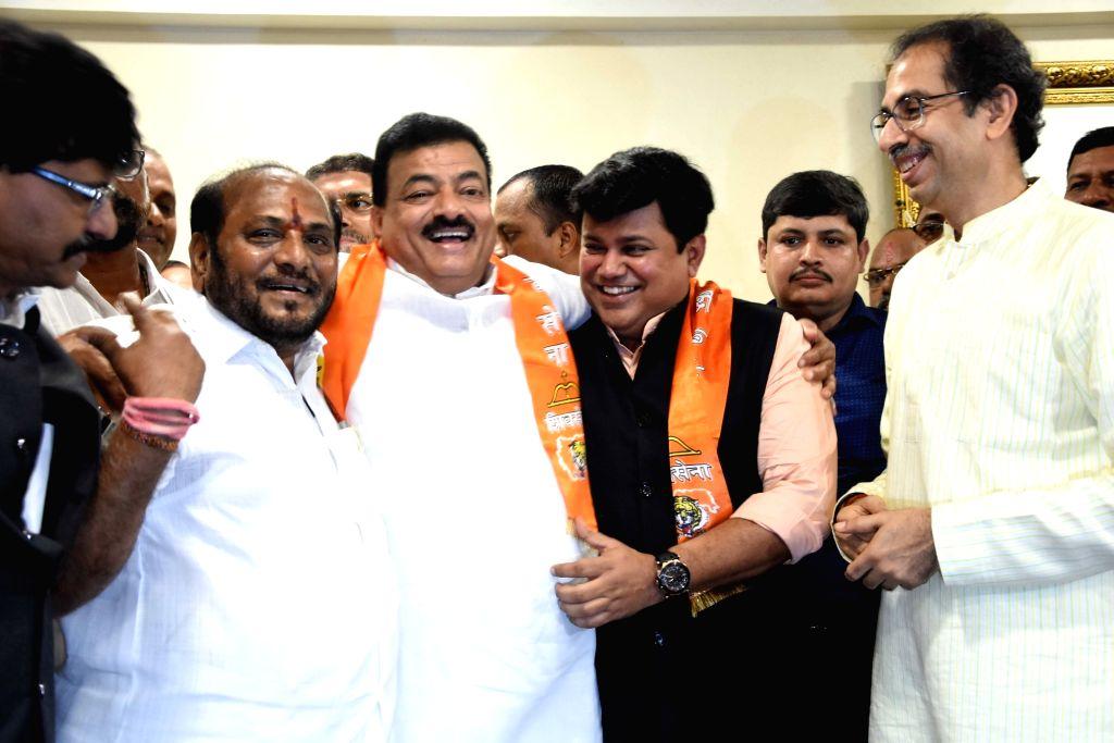 Former Maharashtra NCP President Bhaskar Jadhav joins Shiv Sena in the presence of party President Uddhav Thackeray and Shiv Sena leaders Ramdas Kadam and Uday Samant, in Mumbai on Sep 13, ...