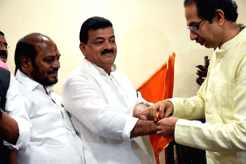 Former Maharashtra NCP President Bhaskar Jadhav joins Shiv Sena in the presence of party President Uddhav Thackeray, in Mumbai on Sep 13, 2019.