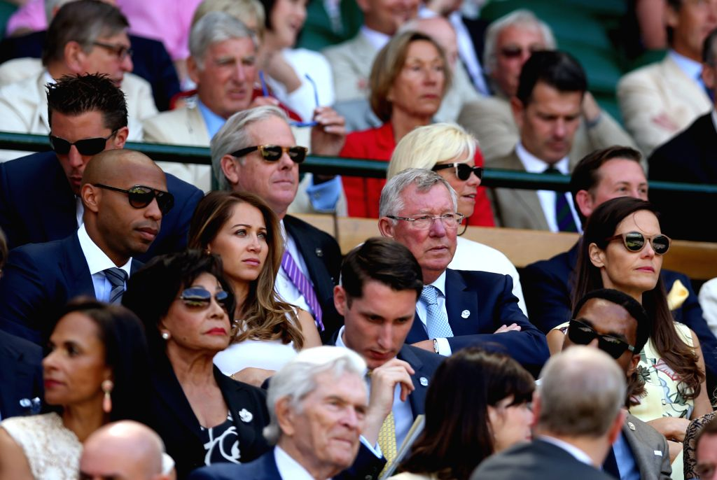 Former Manchester United manager Sir Alex Ferguson and former French footballer Thierry Henry are seen in the royal box on center counrt during day eleven at the ...