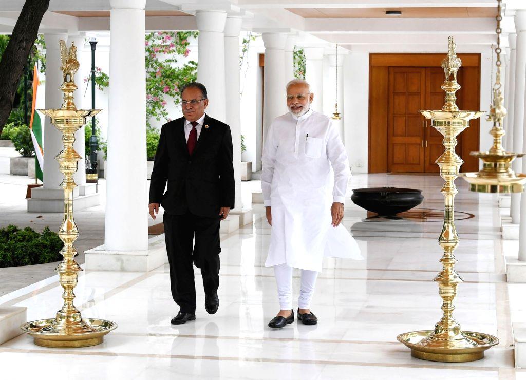 Former Nepal Prime Minister and Nepal Communist Party Co-Chairman Pushpa Kamal Dahal 'Prachanda' calls on Prime Minister Narendra Modi, in New Delhi on Sept 8, 2018. - Narendra Modi