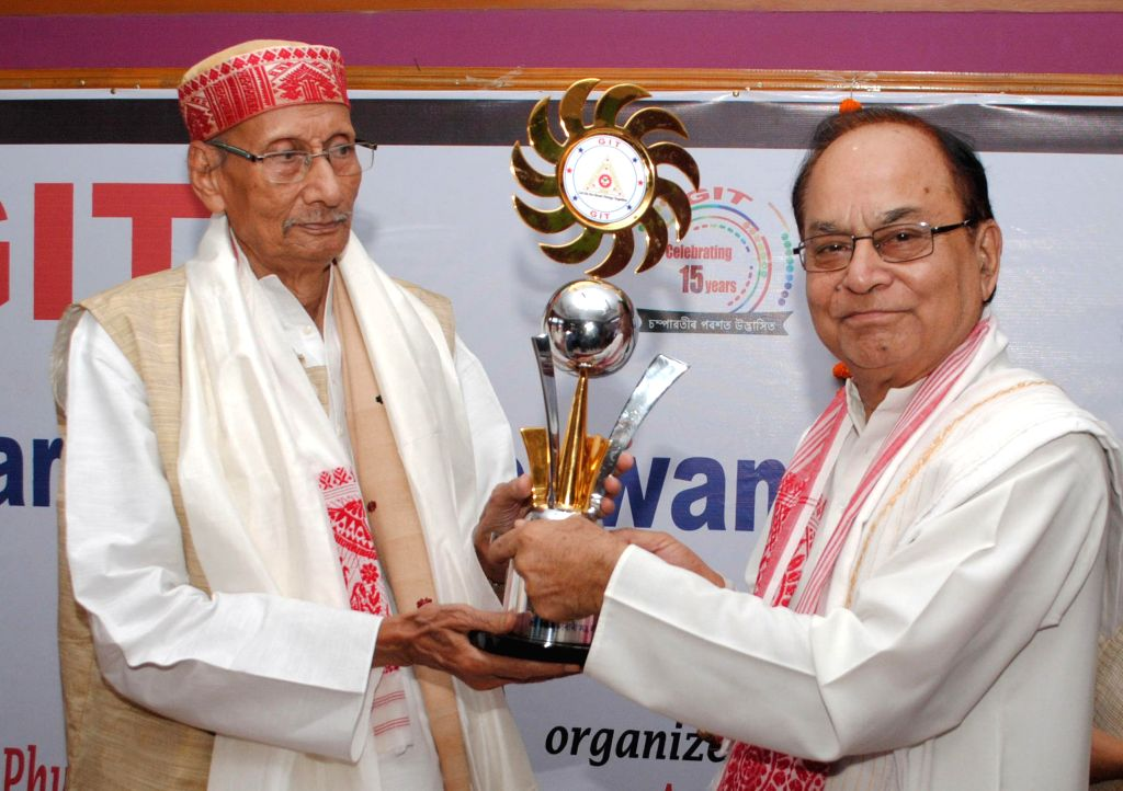 Former President of Assam Sahitya Sabha and senior Journalist Kanak Sen Deka receives Tarun Chandra Goswami memorial GIT National Award-2014 from Jibeswar Goswami, Secretary, Assam Satra Mahasabha ... - Tarun Chandra Goswami and Jibeswar Goswami