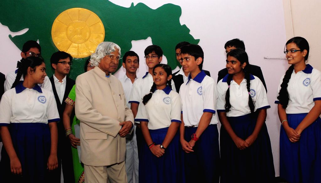Former President of India A.P.J. Abdul Kalam with school students in Hyderabad on August 1, 2014.