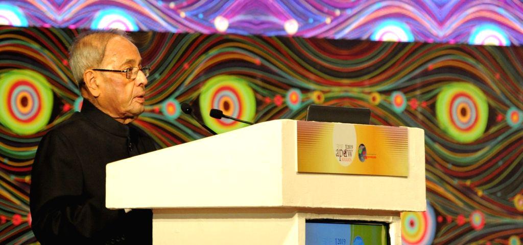 Former President Pranab Mukherjee addresses during the inaugural session of Asian Pacific Digestive Week (APDW) 2019, in Kolkata on Dec 13, 2019. - Pranab Mukherjee