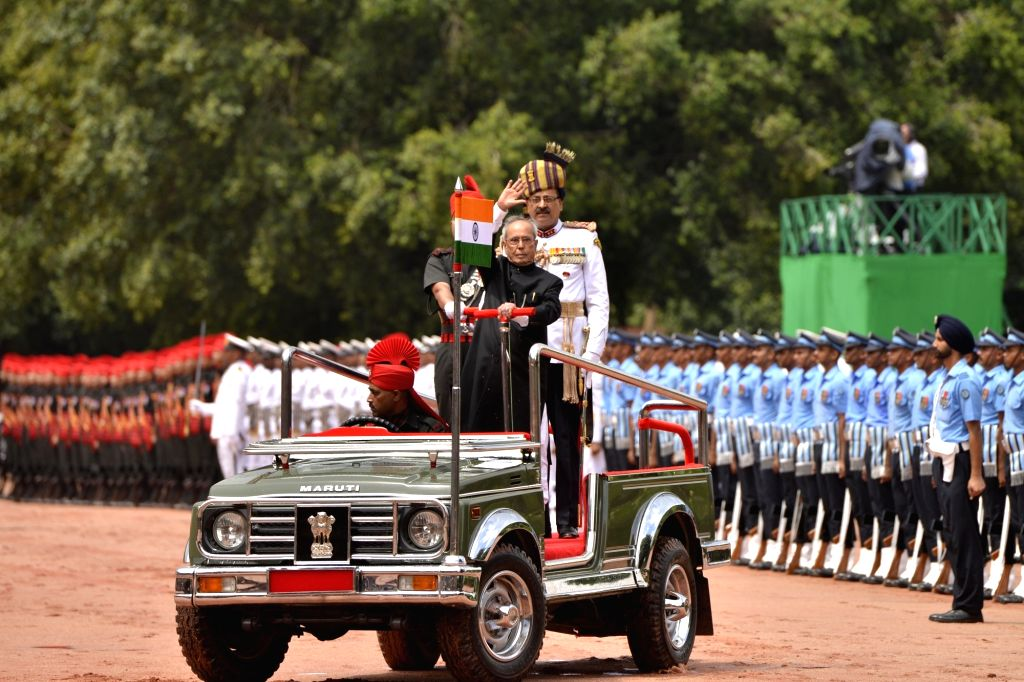 Former President Pranab Mukherjee inspects the guard of honour in the forecourt of Rashtrapati Bhavan in New Delhi on July 25, 2017. - Pranab Mukherjee