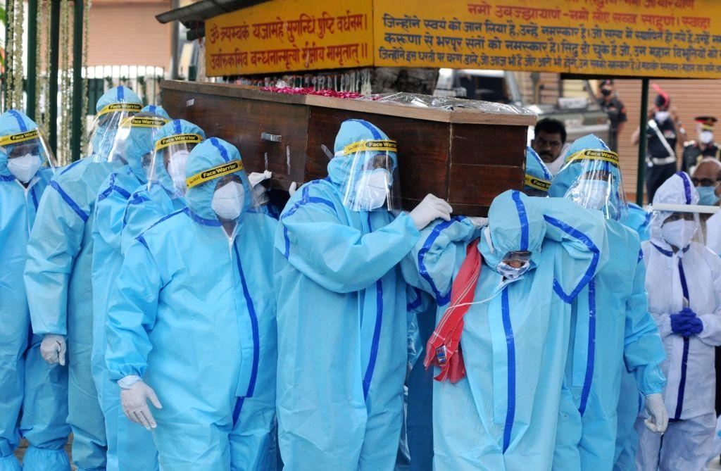 Former President Pranab Mukherjee's mortal remains being brought at the Lodhi Road crematorium for his funeral, in New Delhi on Sep 1, 2020. - Pranab Mukherjee